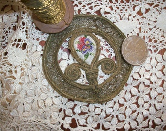 1 metal applique with silk pettipoint center antique