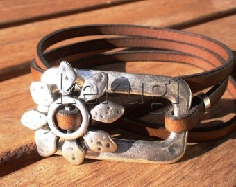 women camel brown leather bracelet  with a flower decoration and a square connector