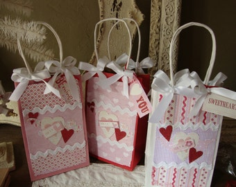 Valentine gift bags embellished paper bags with gift tags red white pink hearts Feb 14th Valentine paper party favors