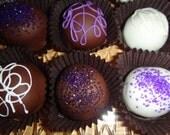 Combination of Dark, Milk and White Chocolate with a Dark, Milk, or White Chocolate Raspberry Center