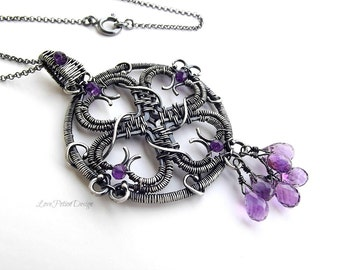 Wire Wrapped Sterling Silver And Purple African Amethyst Necklace With Large Central Medallion.