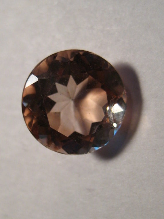 imperial topaz faceted gemstone 10 mm x 6 mm