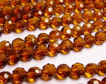 Crystal faceted oval round - 50pcs -  9 mm - AA quality - dark amber - 18 inch strand