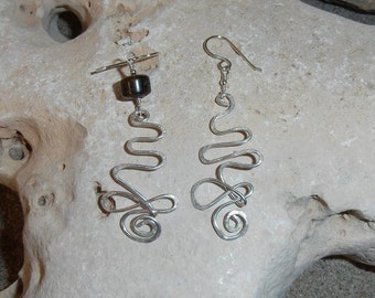 Infinite Earth- These unique earrings are Free Form Hammered Silver and feature an Amber bead and tiny Silver beads.