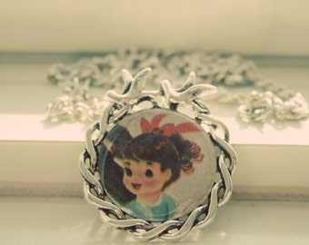 Girl with ponytail vintage necklace