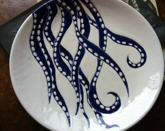 Navy blue octopus decor, round ceramic platter and dinner plate by Jessica Howard Ceramics