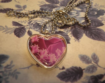 Pink Flowers in a Silver Heart Pendant Necklace