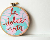 "Embroidered Hoop Sign ""la dolce vita"" Cotton Fabric Wall Piece. Red Stitched Phrase on Pastel Paisley. Handmade by merriweathercouncil - merriweathercouncil"