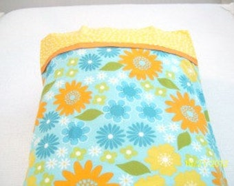 Standard size pillowcase cover in bright blue, yellow and orange flowers.
