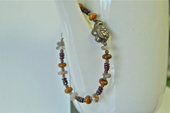 Mens Pyrite and Garnet Bracelet with a Pyrite Turtle and Stainless Steel Clasp from North Atlantic Art Studio