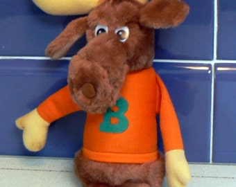 Vintage 1982 Moose with orange sweater