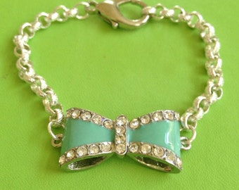 Crystal Bow and Silver Bracelet
