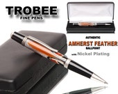 Truly a work of art pen - professionally crafted by hand - Amherst feather encased in clear acrylic