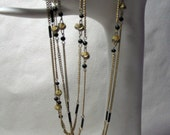 Lovely Antique 30 inch Double Strand Necklace, 7 Stations of Love Knots, Paperclip Links and Black Beads