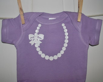 The Carrie Pearl Necklace with Bow in Lavender Onesie with White Pearls and Bow