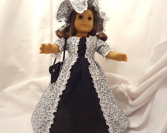 Black floral on white, long dress for 18 inch dolls, with solid black inset and white lace trim.