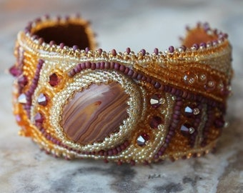 bead embroidered cuff in plum and gold