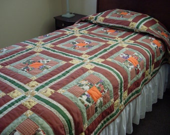 Handstitched Twin Quilt in Browns, Orange, and Greens