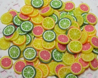 Polymer clay citrus fruit slices 100 pcs for miniature foods decoden and nail art supplies lemon lime orange pink grapefruit