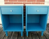 pair mid-century modern laminate top one drawer nighstands. deep teal blue. white. nat & cole