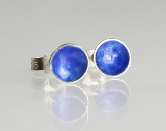 Tiny sterling silver stud earrings with sapphire blue enamel