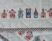Two(2) Mug Rugs  A Row of Birdhouses on a Tan Print covered withTiny Birds