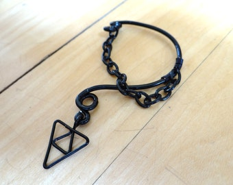 The L.O.Z.® Dark Link Inverted Triforce of Wisdom Ear Bend