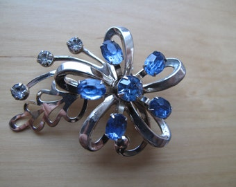 silver tone blue starburst brooch pin with rhinestones