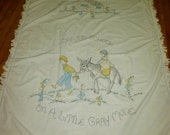 Coverlet: Hand embroidered and tinted child's coverlet     Off to school on a little mule