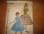 Simplicity Pattern 2204 Girls' Blouse And Jumper  circa 1957