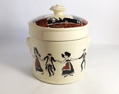 Sarreguemines lidded pot with dancers from Alsace and stork decoration.