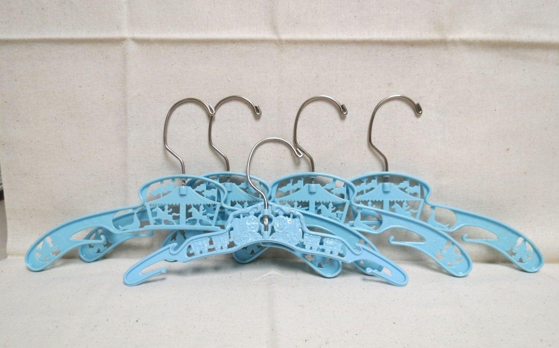 vintage plastic childrens clothes hangers blue