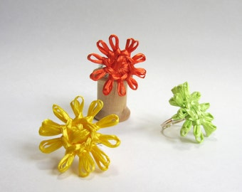Abigale's flower rings. Three flower rings woven in orange, yellow and lime green with vintage Swistraw by Ruby Buffalo.