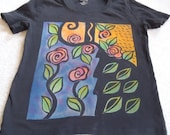 Woman's large discharge t-shirt with a collage type design with roses, and leaves, painted with procion dyes