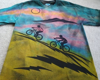 Two bikers enjoying the mountains and a beautiful sunset, man's medium discharge t-shirt with dyes added, turquoise, pink, orange, green