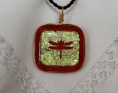 Dichroic glass pendant: Red dragonfly peaks through gold dichroic glass