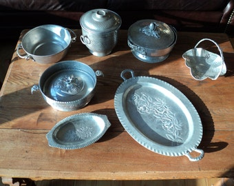 10 Vintage Pieces of Solid Cast Aluminum serving pieces with various bowls, platters, casseroles and an Ice Bucket with Lid with good patina