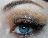 Evil Eye eyeshadow- semi-matte bright true red orange