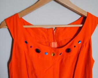 Orange Dress with Fancy Jewelry