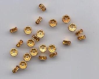 48 vintage Swarovski rhinestone rondelles - 6 mm topaz/gold plated