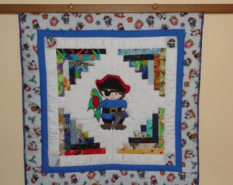 """Appliqued """"Little Boy"""" Pirate Baby Quilt,  Extra Large Appliqued Pirate has eyepatch and a Parrot on his shoulder."""