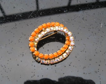 1960s orange glass and aurora borealis brooch
