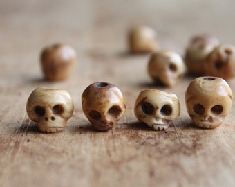 Ventanas Carved Bone Skull Beads (4) - Perfect for El Dia de Los Muertos Jewelry and Shrunken Head Coolness