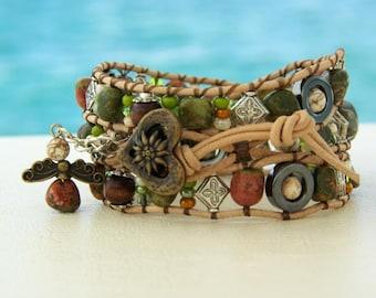 Edelweiss... Leather wrap bracelet... typical Bavarian triple wrap bracelet. Original OceanBead style.
