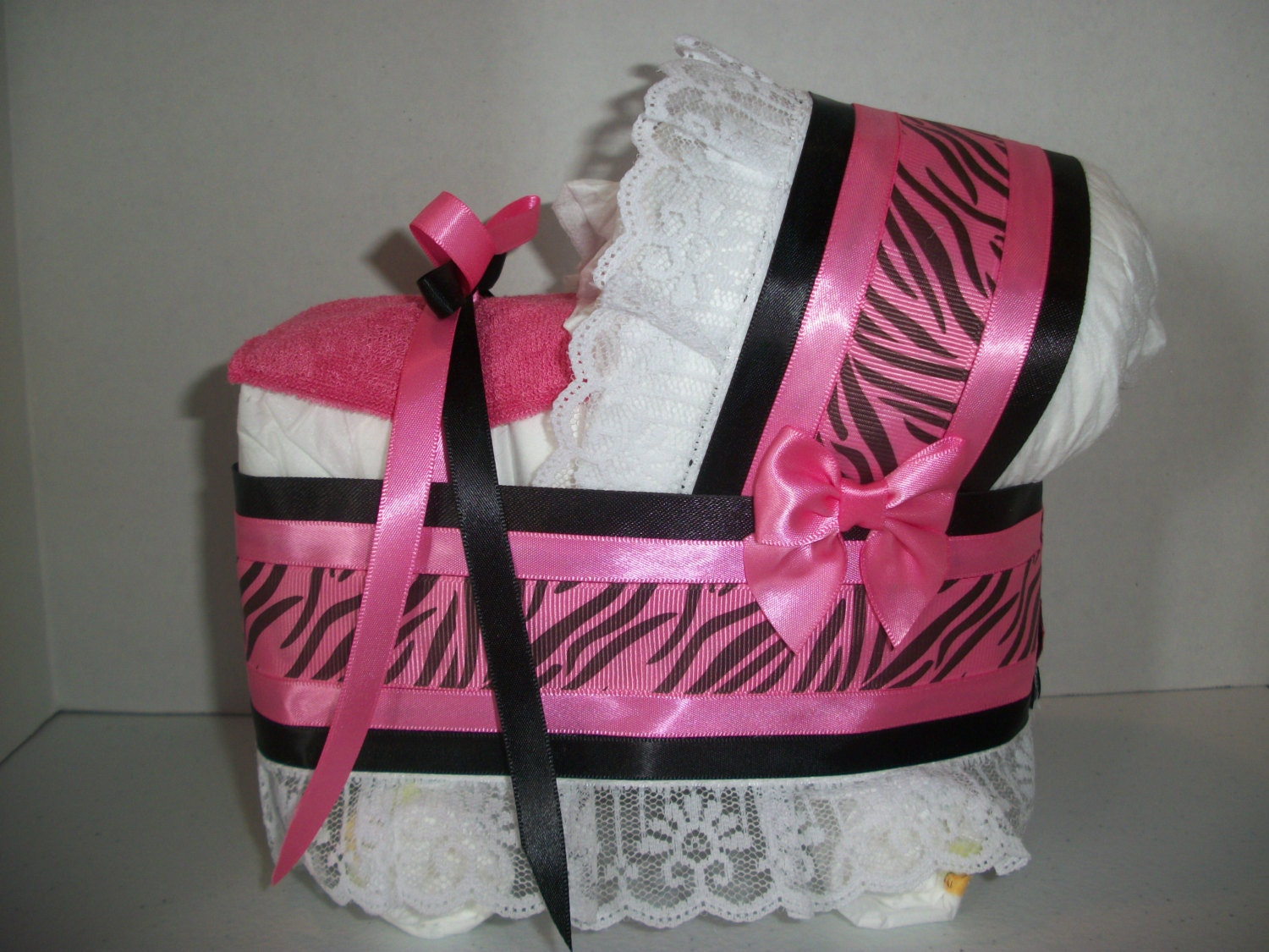 Hot pink and black zebra print girl diaper bassinet baby for Animal print baby shower decoration ideas