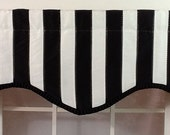 Black and white striped shaped valance with black pleated French pleated ribbon trim