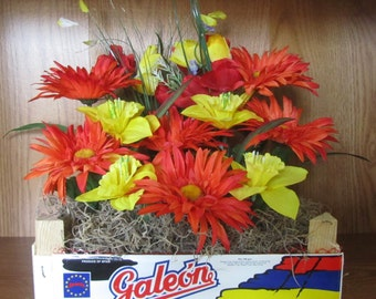 Wooden Crate filled with Orange Spider Daisies, Yellow Daffodils, and Yellow and Red Tulips