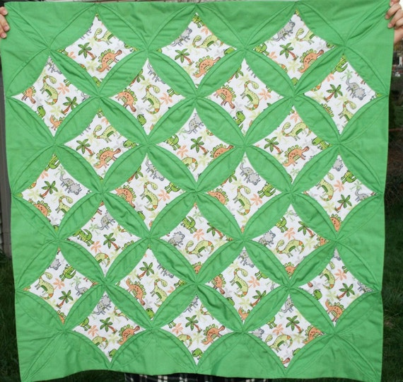 Baby quilt dinosaur fabric cathedral design 15 off for Baby dinosaur fabric