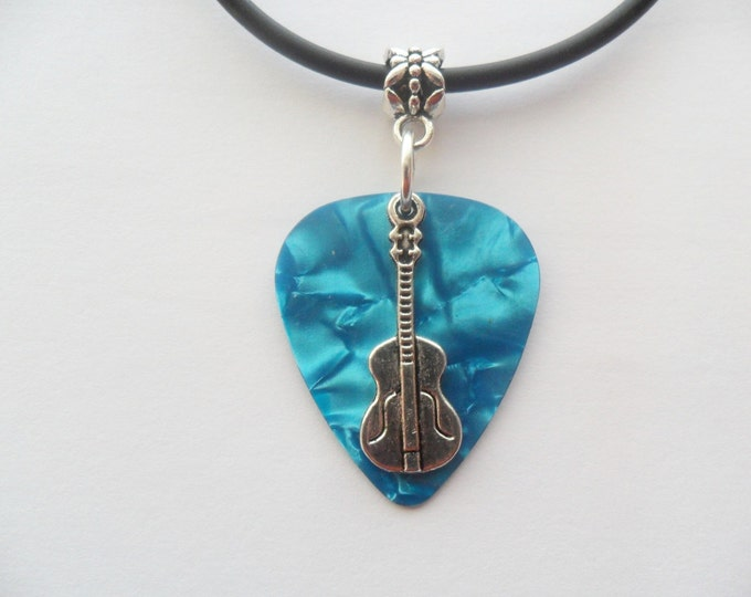 Turquoise guitar pick necklace with guitar charm and adjustable cord.