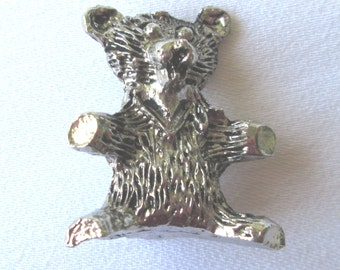 Little Bear statue in silver metal
